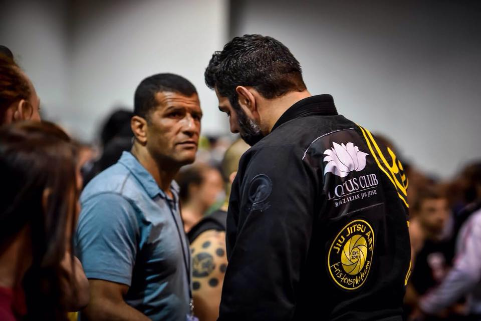 Coach Foster consults with Giva Santana--photo courtesy of James Foster