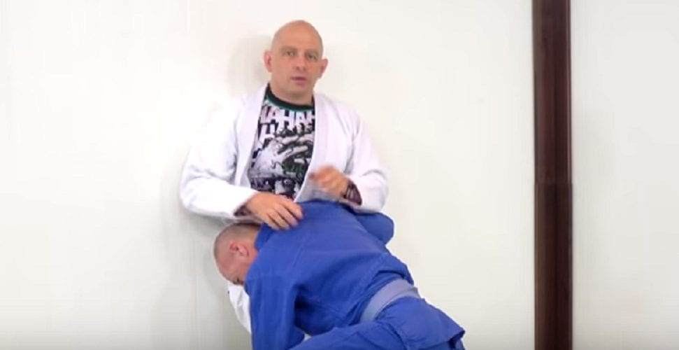 Beginning and ending one's BJJ training with some simple wall stretches helps circulate the blood and ready the mind.--Photo courtesy of Sebastian Brosche